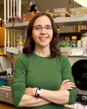 Rachel Adams in front of lab bench