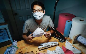 Christopher Gee making masks at a desk
