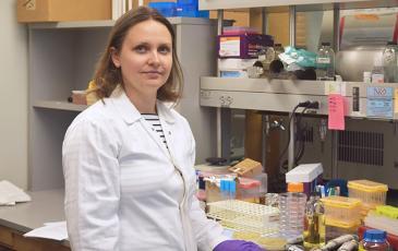 Ksenia Krasileva standing in her lab