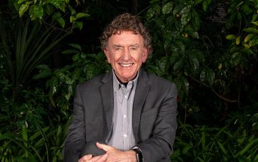 Gordon Rausser portrait, sitting in garden