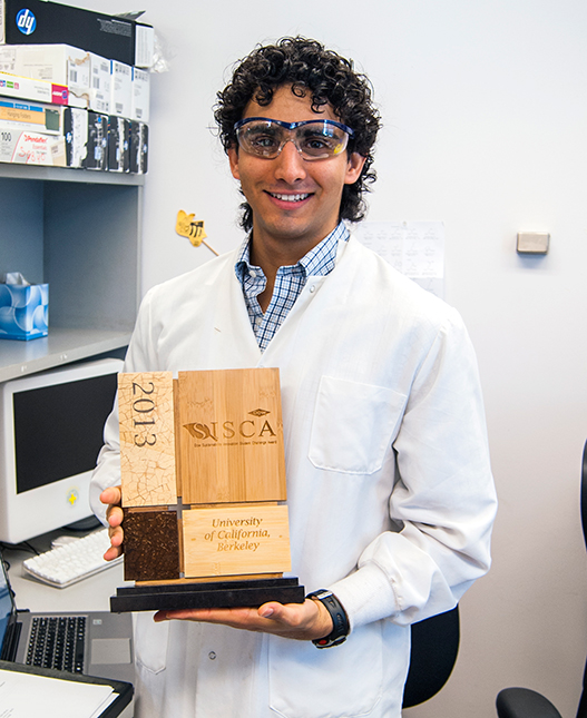 Graduate Student Michael Gomez with his prize trophy